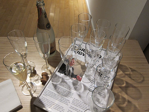 Sparkling wine and a custom drinks tray at the opening of Dominion Modern's Toronto Subway exhibit.