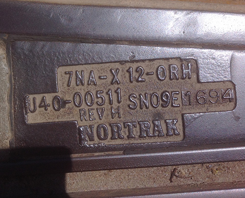 "Embossed lettering on TTC streetcar tracks: ""7NA-X 12-ORH, J40-00511 REV H SN09E 1694 NORTRAK"""